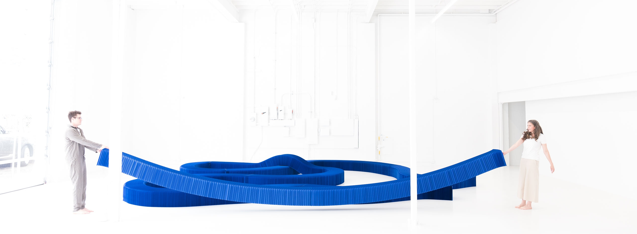 The modular paper furniture collection by molo includes this Klein blue expanding paper bench with magnetic connectors.