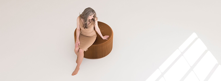 large paper stool or table that can stretch into a long paper bench.