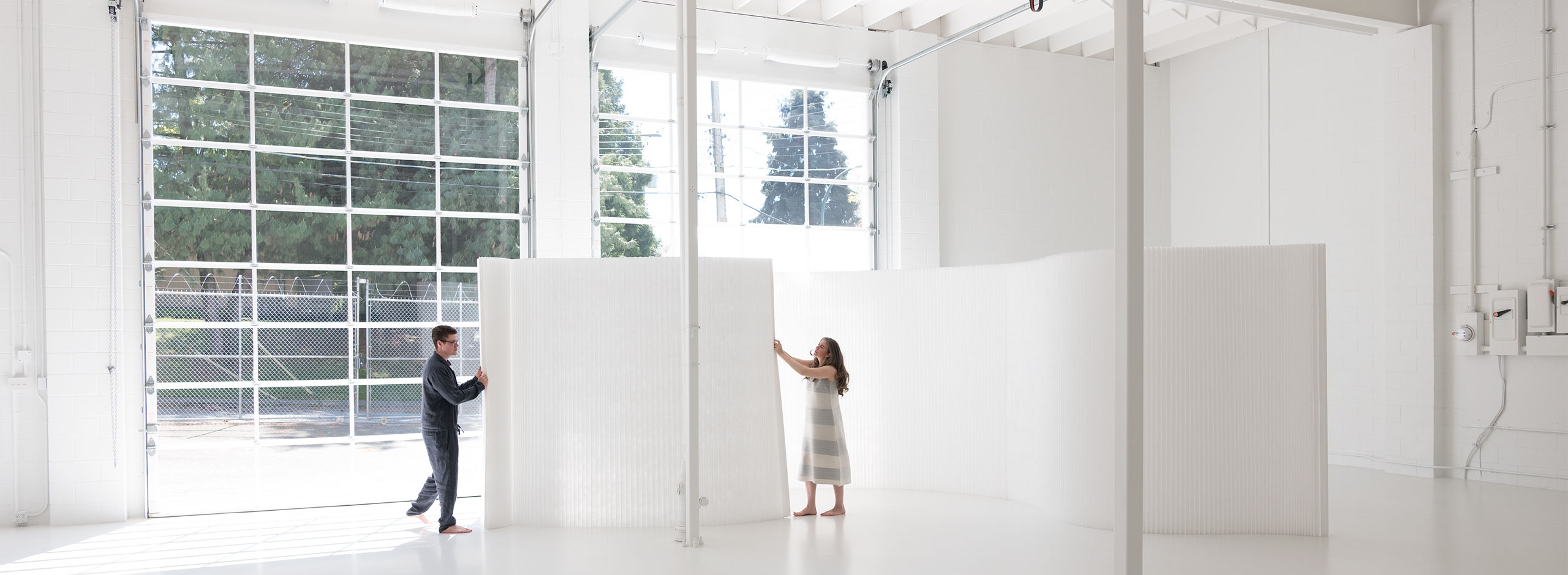 textile softwall is a folding partition that is expandable or can compress to flat pack for easy storage and shipping. Designed by molo this freestanding room divider comes in a variety of heights and has a modular magnetic connection system.