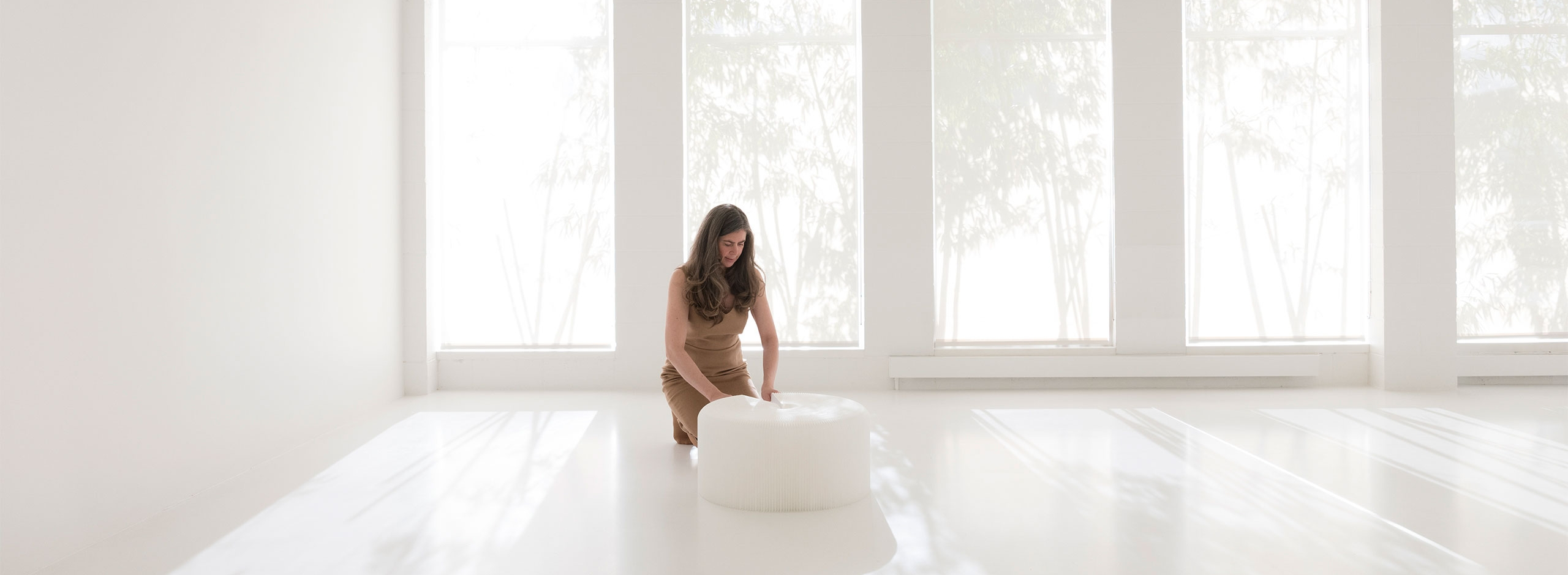 The softseating folding paper stool by molo is available two materials and several colors. This white stool is a paper-like, water resistant textile. Original design from the collection of paper furniture designed by Stephanie Forsythe and Todd MacAllen.