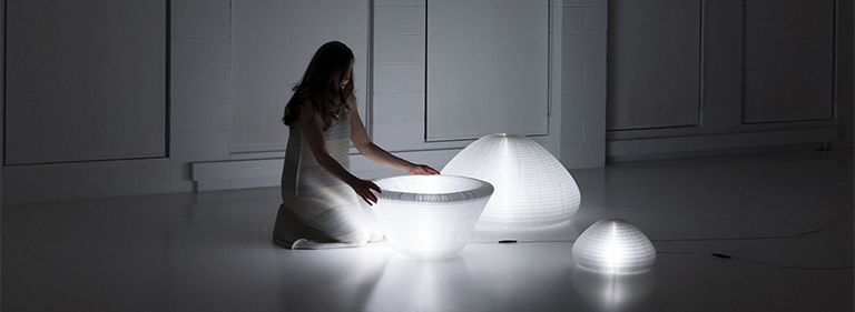 A paper lamp with shifting form, urchin softlight is designed by Stephanie Forsythe and Todd MacAllen for molo.