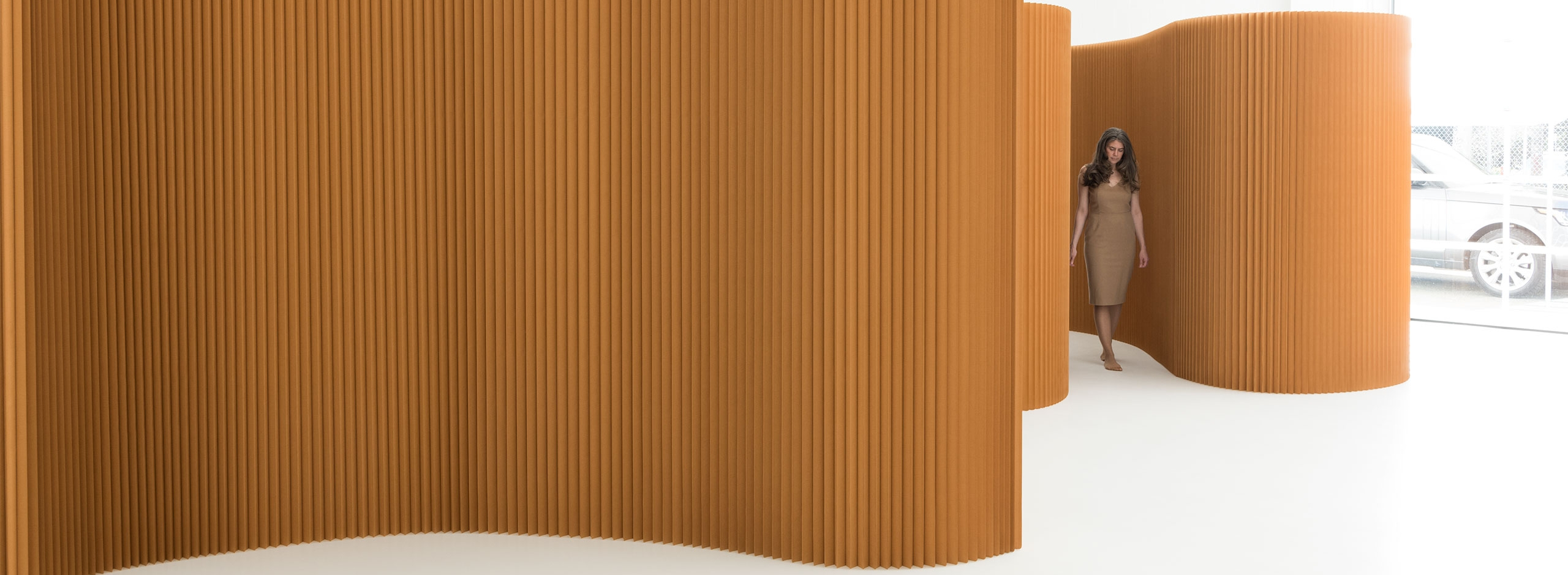 softwall acoustic partitions that can be made into any shape, these paper room dividers make for sculptural back drops as well as practical privacy screens.
