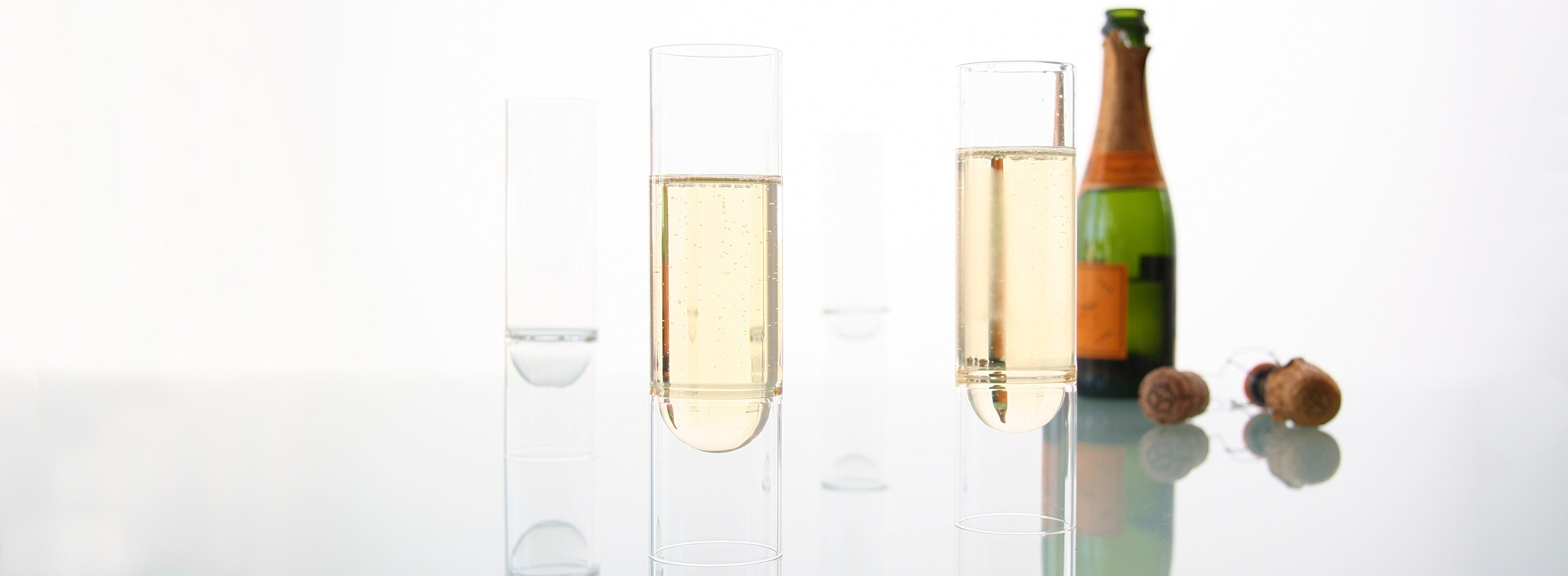float champagne flutes accompanied by a bottle of bubbly