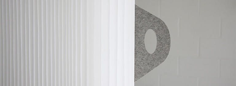 textile softwall with felt handle.