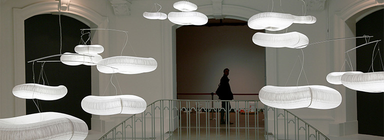 A mysterious skyscape of illuminated cloud softlight mobiles.