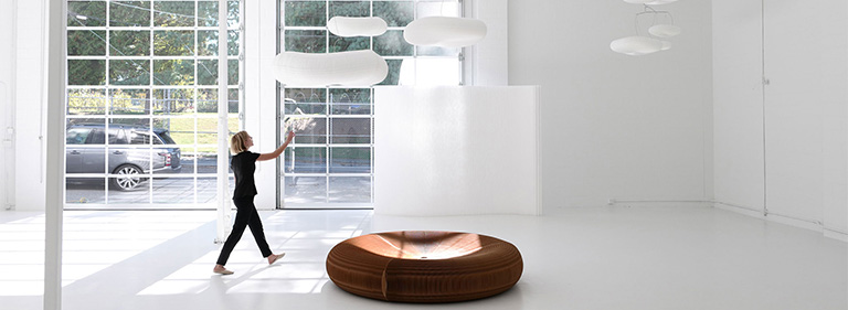 cloud lamp mobile with folding seating paper furniture below by molo.
