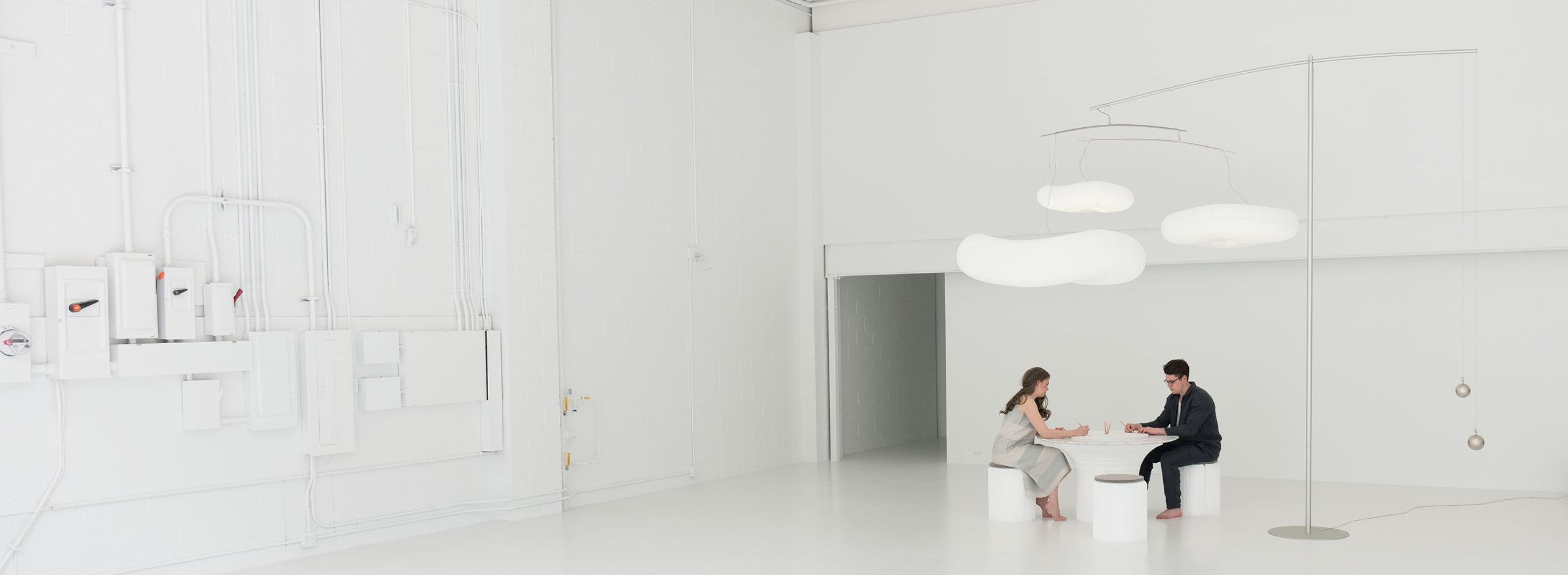 molo's paper furniture includes flexible paper stools and tables, as well as lighting.