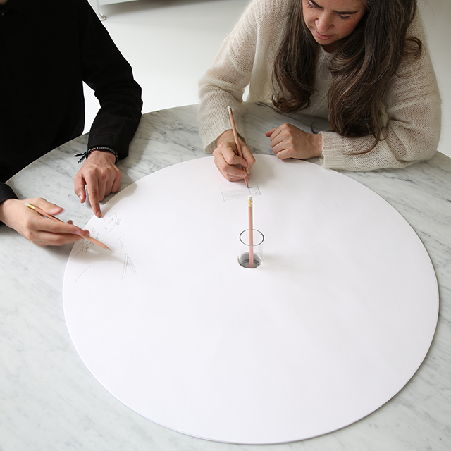 two people draw on molo's sketching circles accessory for cantilever table
