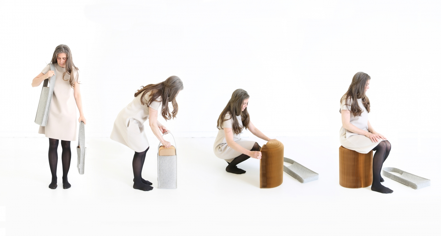 woman demonstrates the convenient portability of softseating fanning stool with felt tote