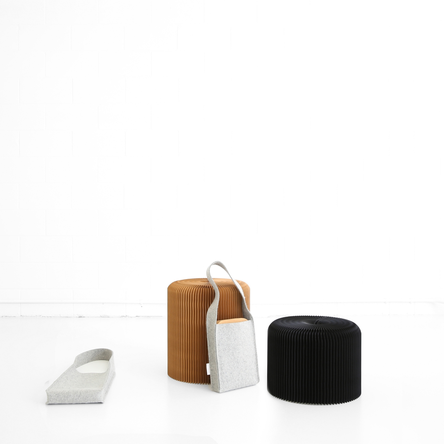 two examples of molo's softseating fanning stool with felt tote