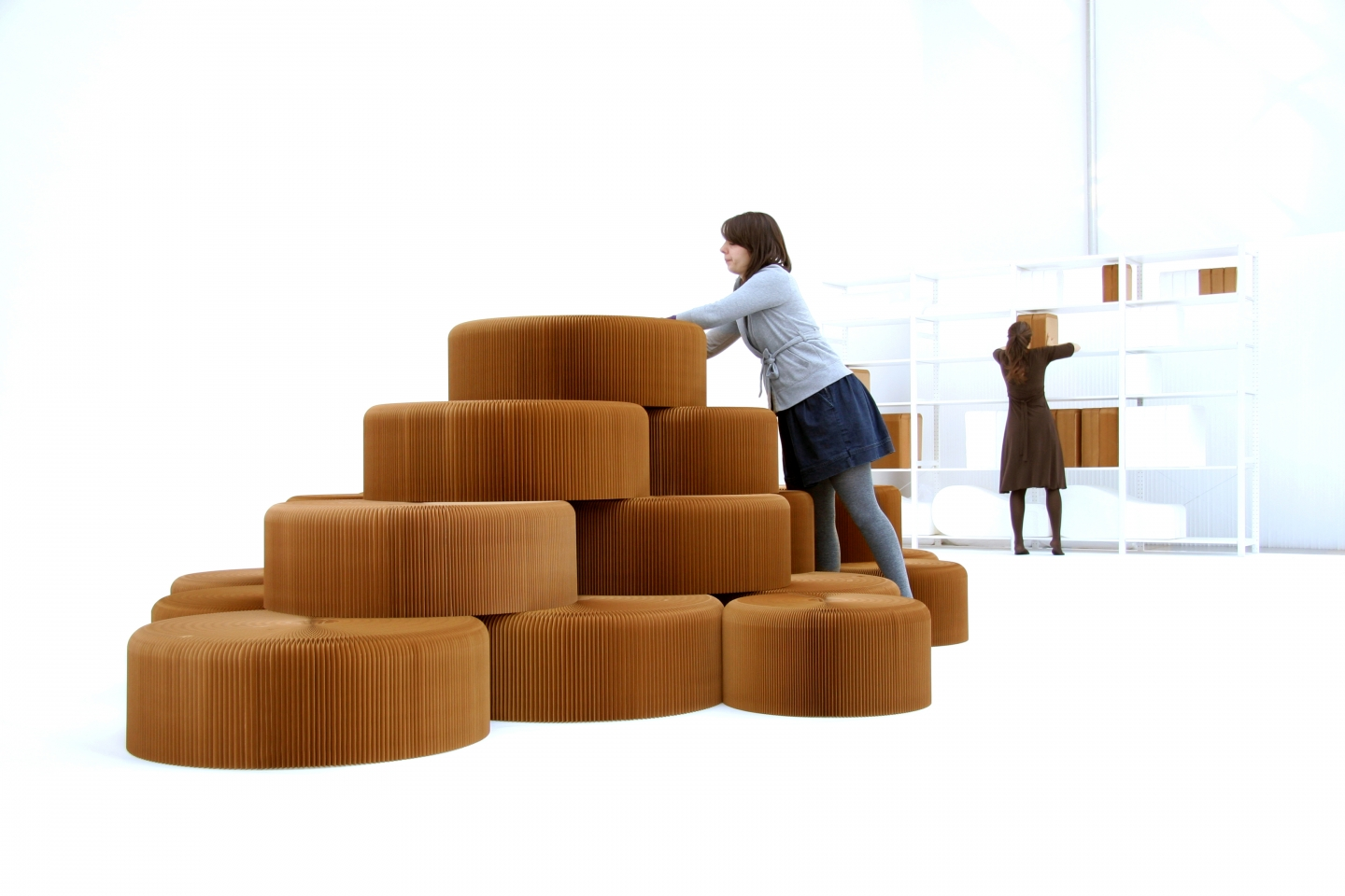 making a seating hill from stacked softseating fanning stools