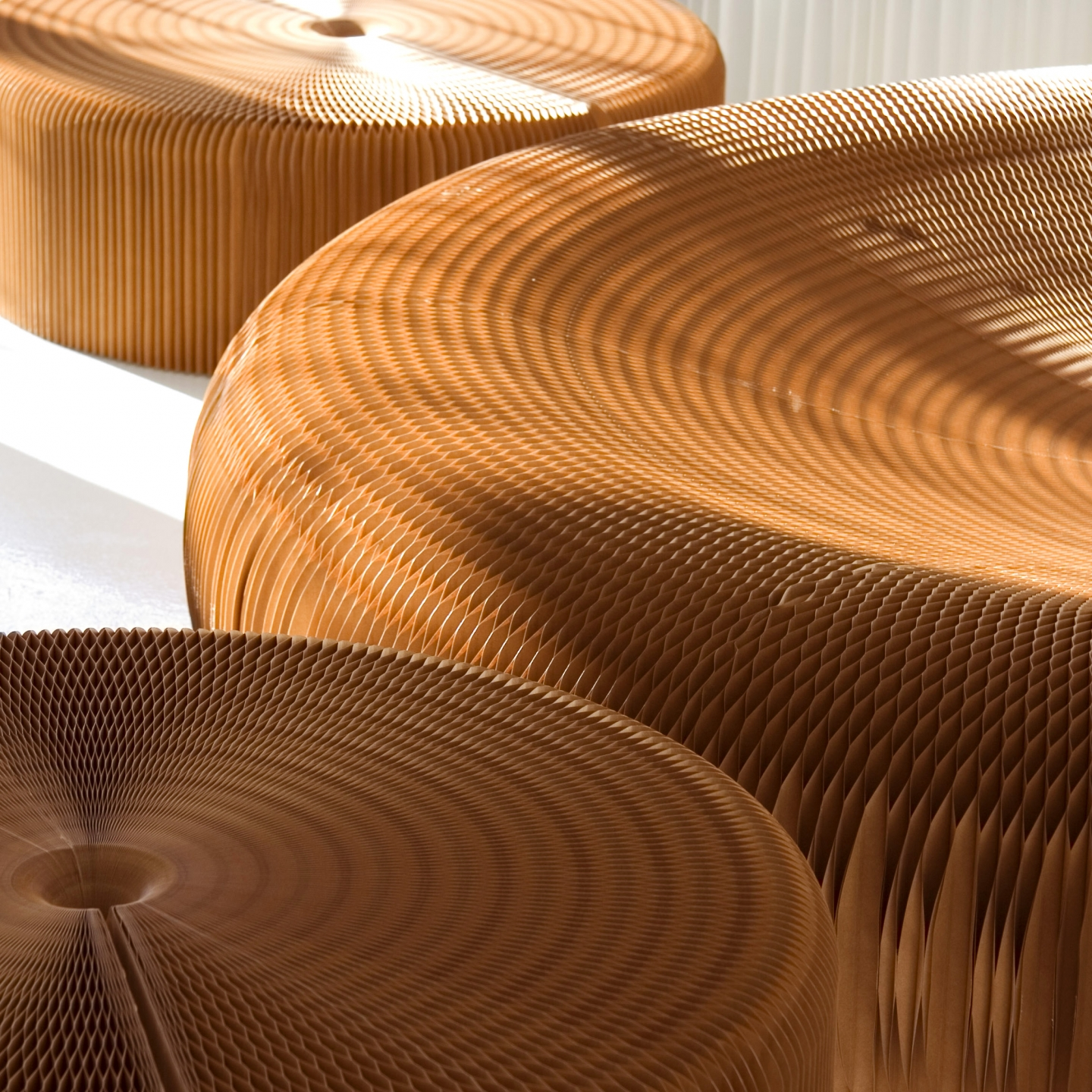 detail of paper softseating dappled by sunshine