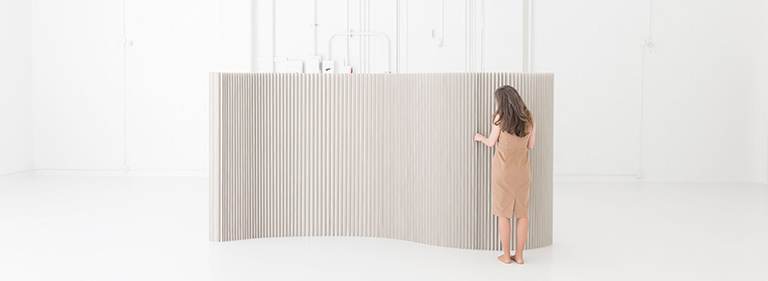 textile softwall acoustic wall made in custom color Pantone Warm Gray 4. This folding paper wall is made by molo.