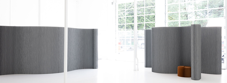 textile softwall acoustic wall made in custom color Pantone Cool Gray 6. This folding paper wall is made by molo.