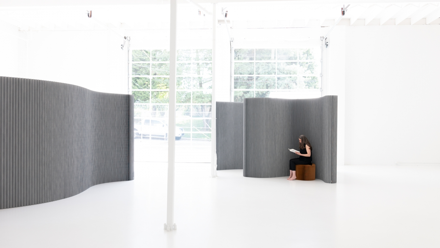 softwall, a flexible room divider, rearranges space.