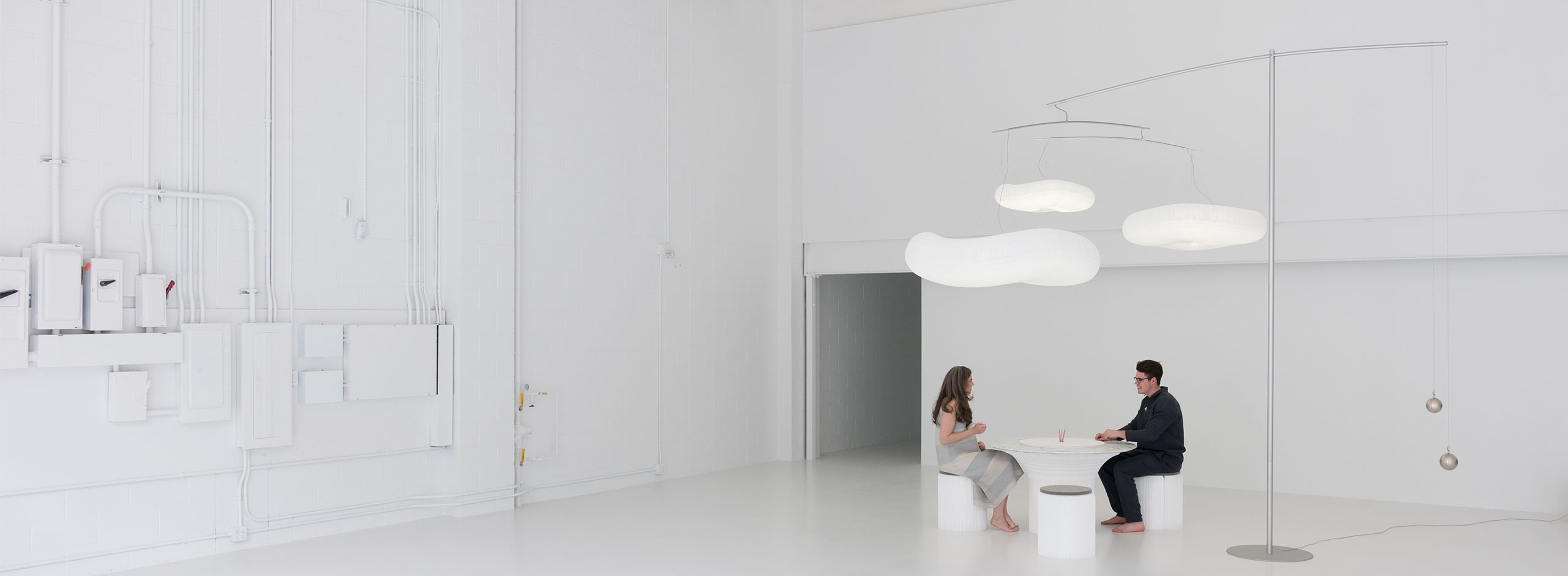 folding paper furniture under paper cloud lamp designed by Stephanie Forsythe and Todd MacAllen of molo.