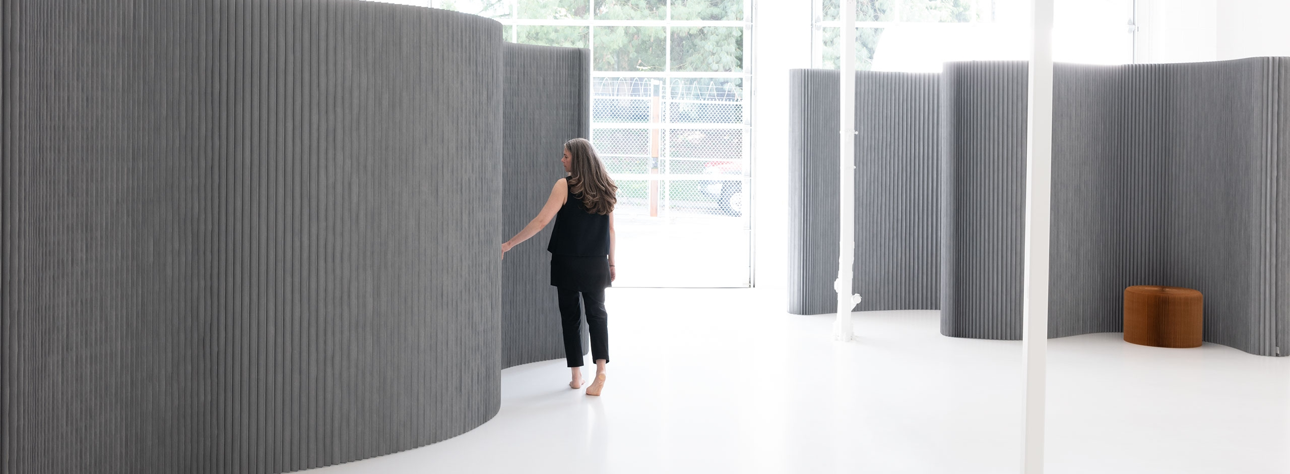 This folding wall can be arranged into any shape as an acoustic wall, event backdrop or room divider.