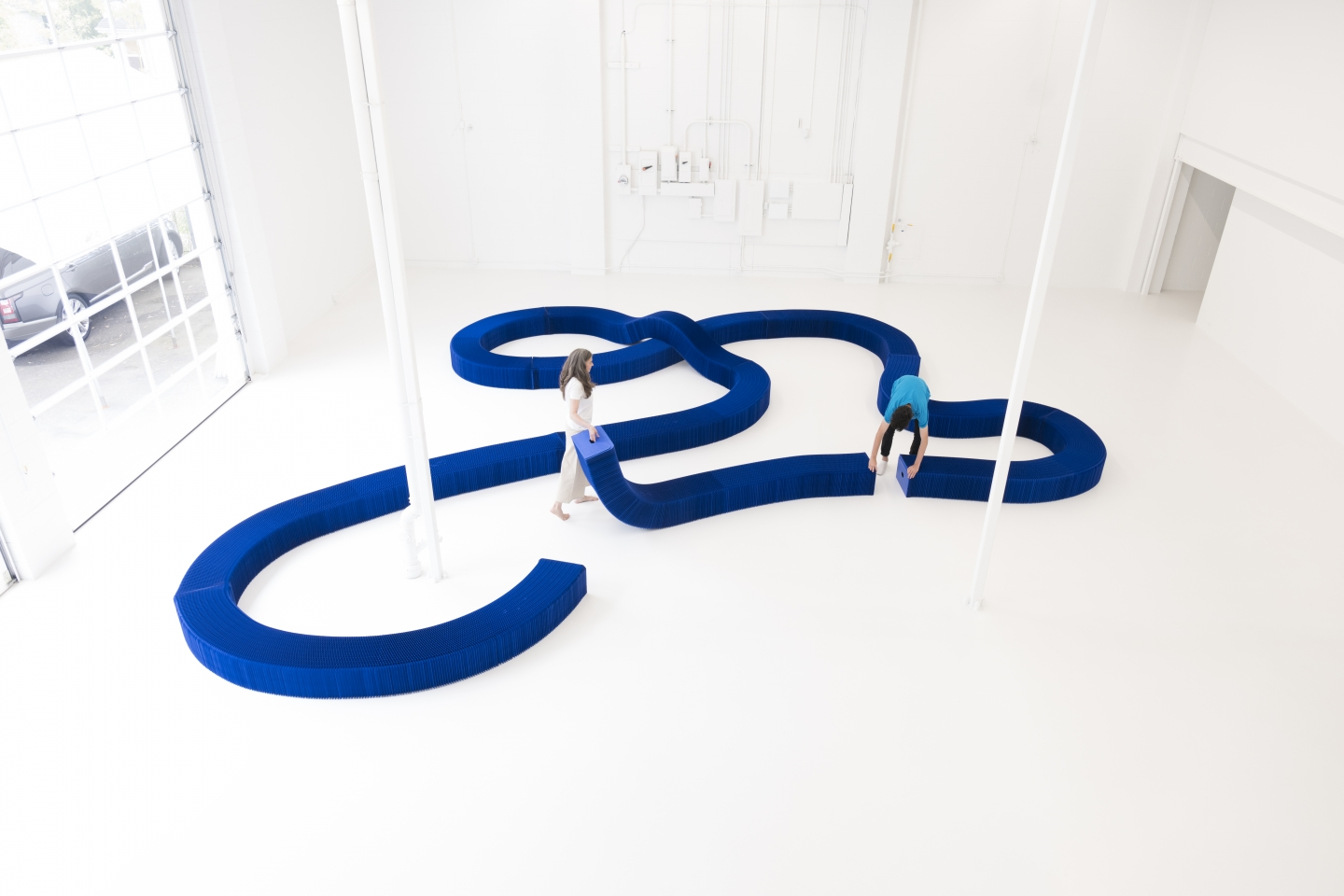 Indigo paper softseating connected to form a serpentine bench.