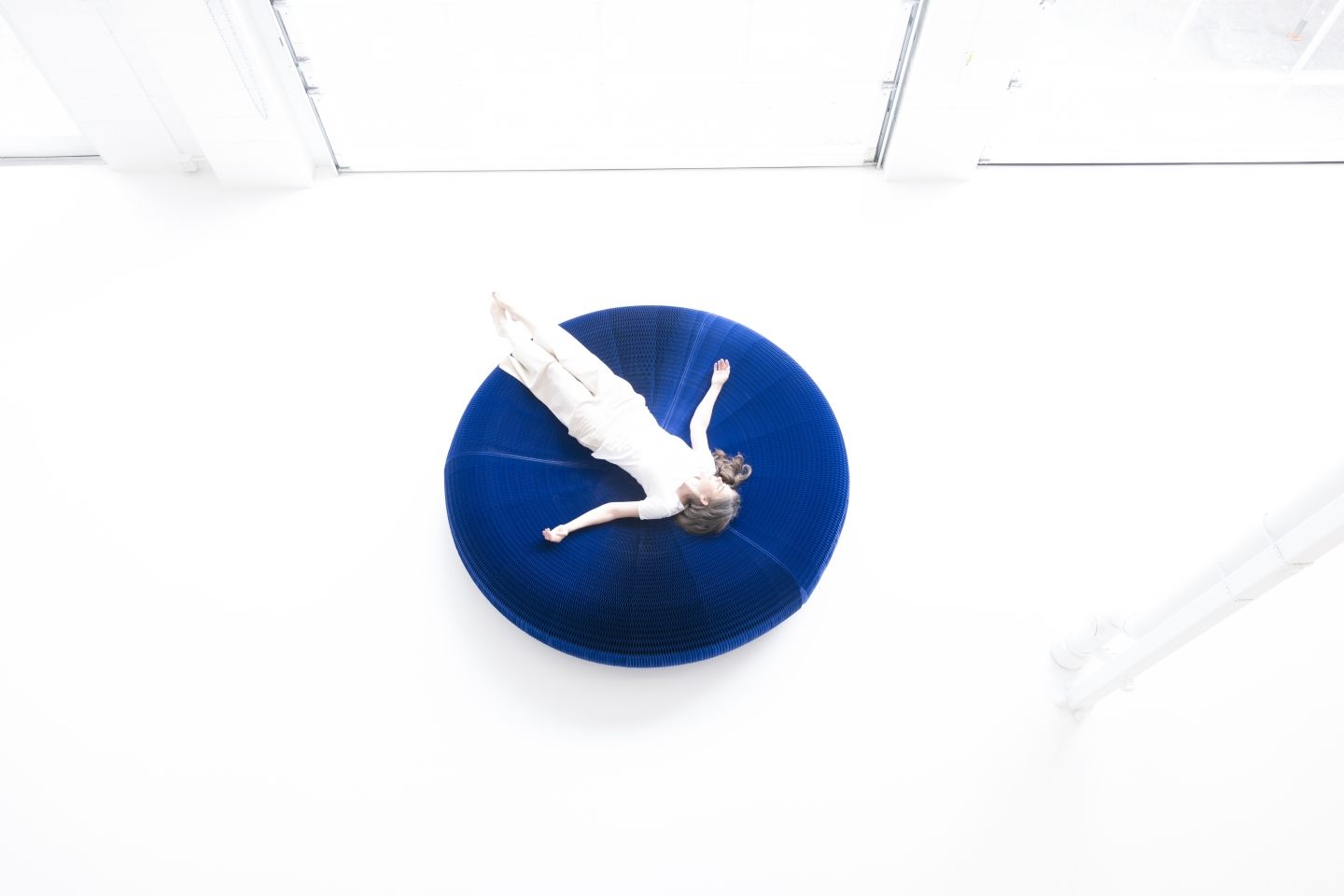 Floating away on an indigo softseating lounger.