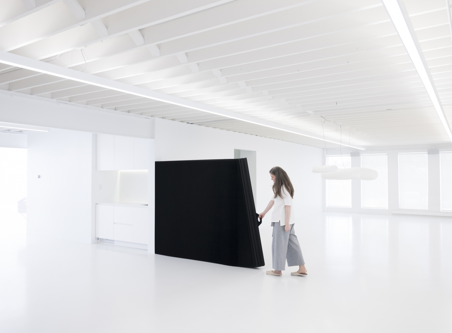 black paper softwall used as a sliding door and room partition.