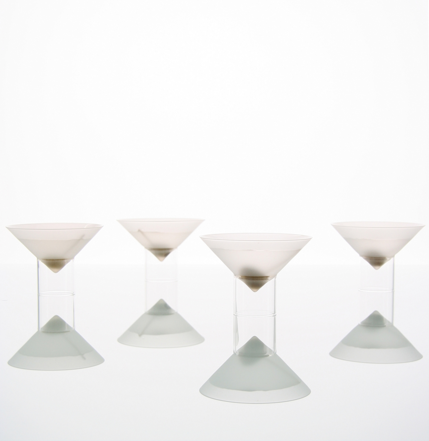 four dirty martinis in float martini glasses