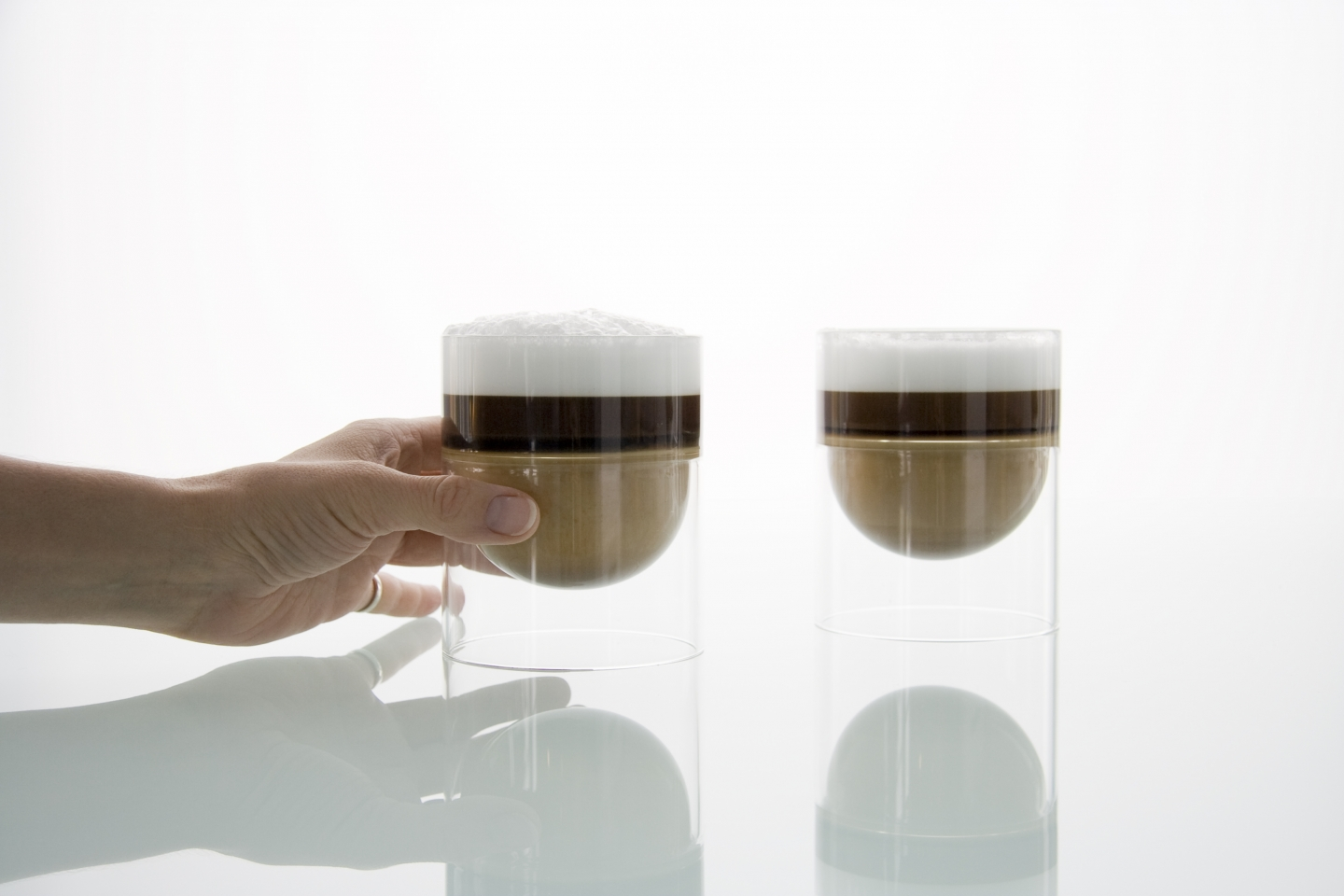 two cappuccinos in float wine glasses