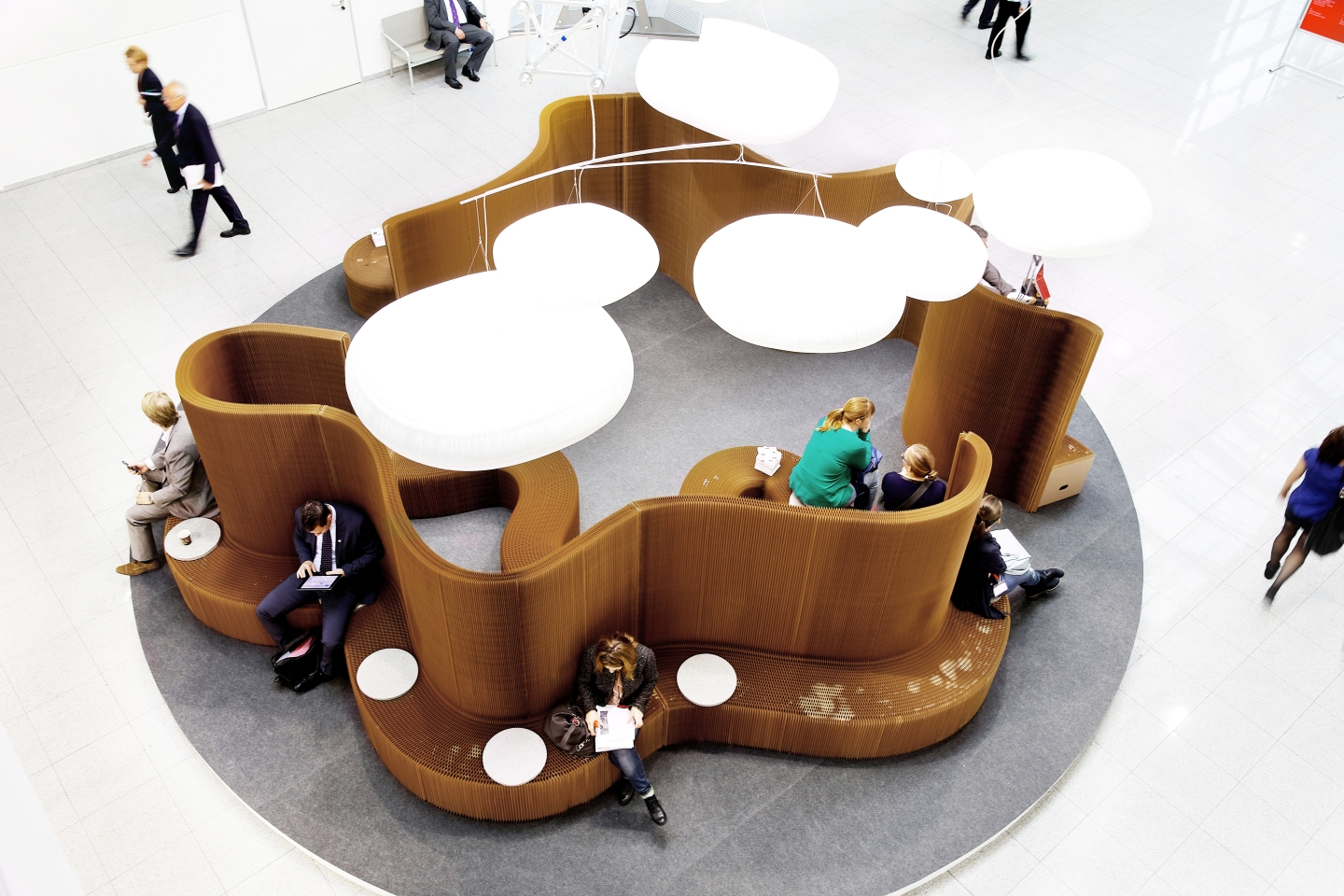modular wall partitions, paper seating illuminate by its cloud lighting - accordion paper furniture by molo