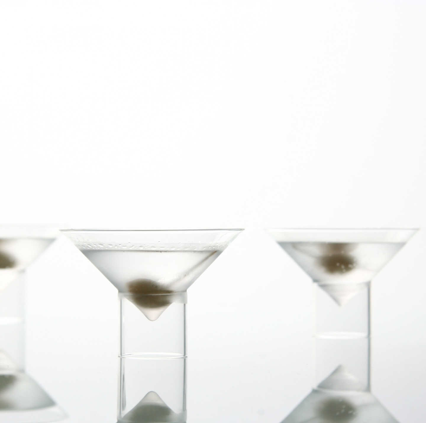 dirty martinis in float martini glasses