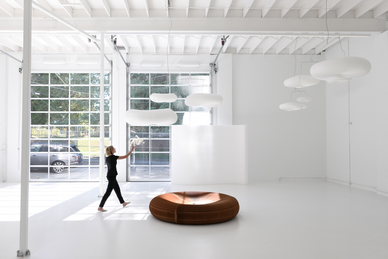 woman walks towards a hanging cloud mobile