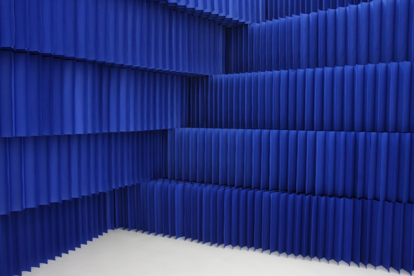 indigo blue paper blocks stacked to form a textural space partition with acoustic attenuation properties