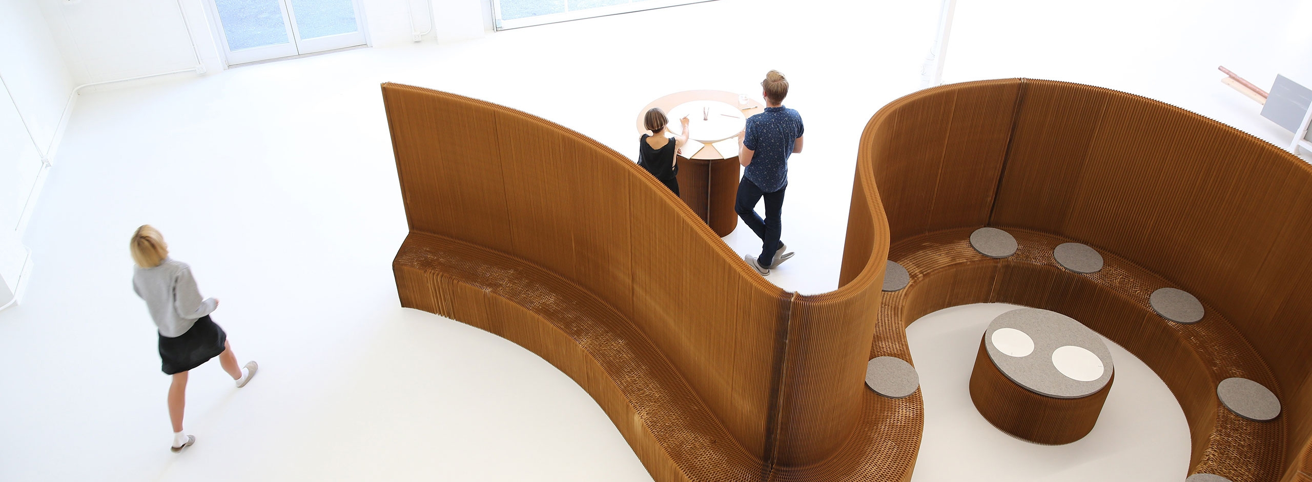 a meeting room made from benchwall, softseating and cantilever table