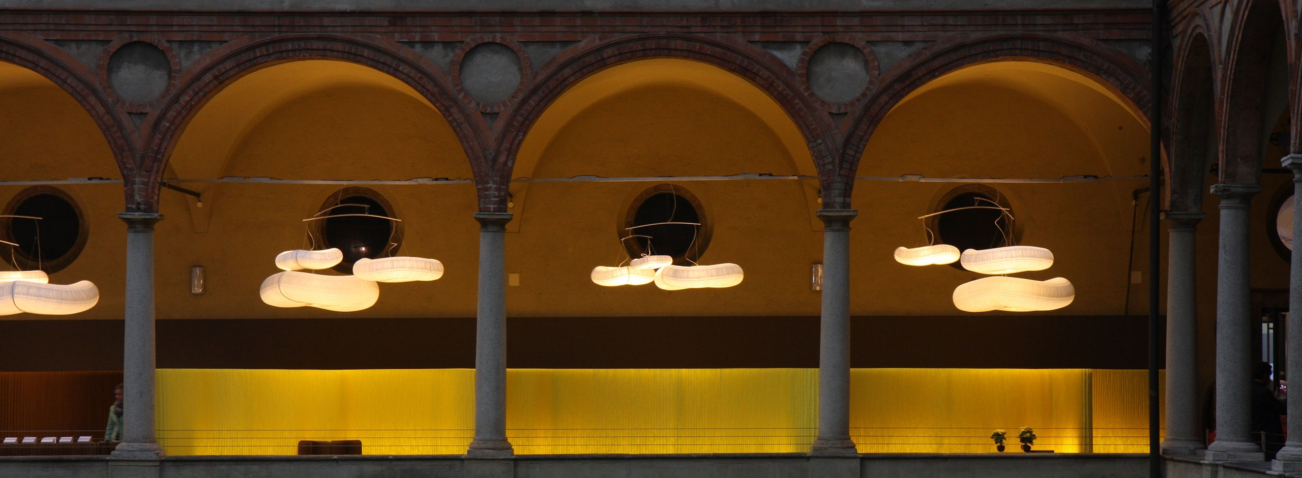yellow textile softwall with cloud mobiles in Italy for the paper music exhibition - acoustics
