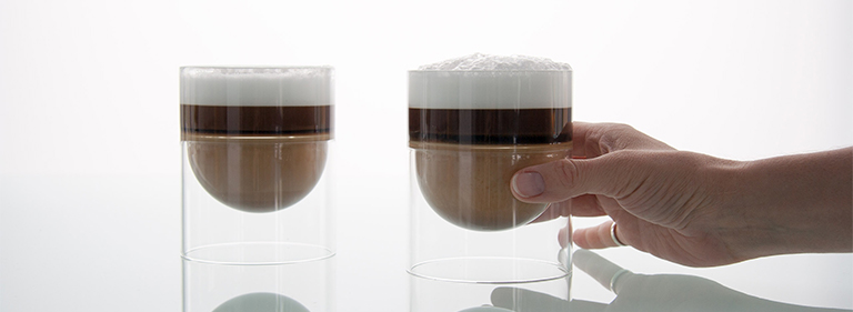 Two foamy cappuccinos in float.