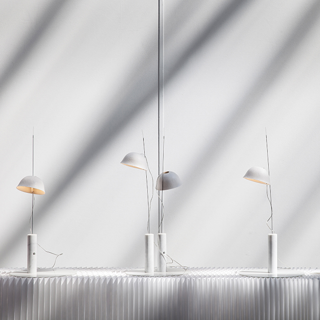 cappello light / table lamp by molo - shadows fall across four cappello arranged along a white textile softblock