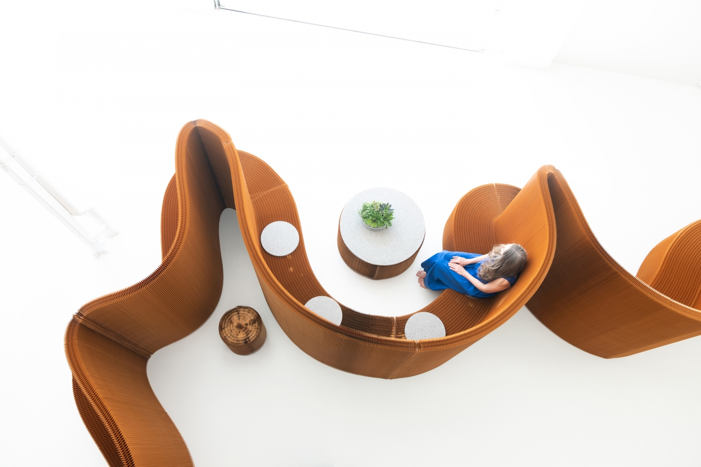 benchwall, a flexible furniture system, creates meeting rooms for open concept office space
