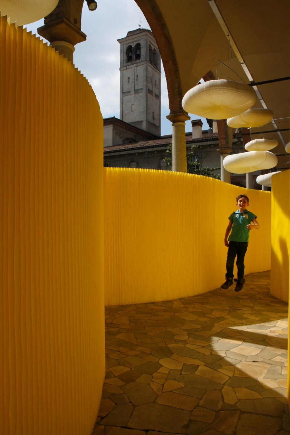 room divider textile softwall in a custom yellow colour and cloud mobile softlight for MOST in Milan