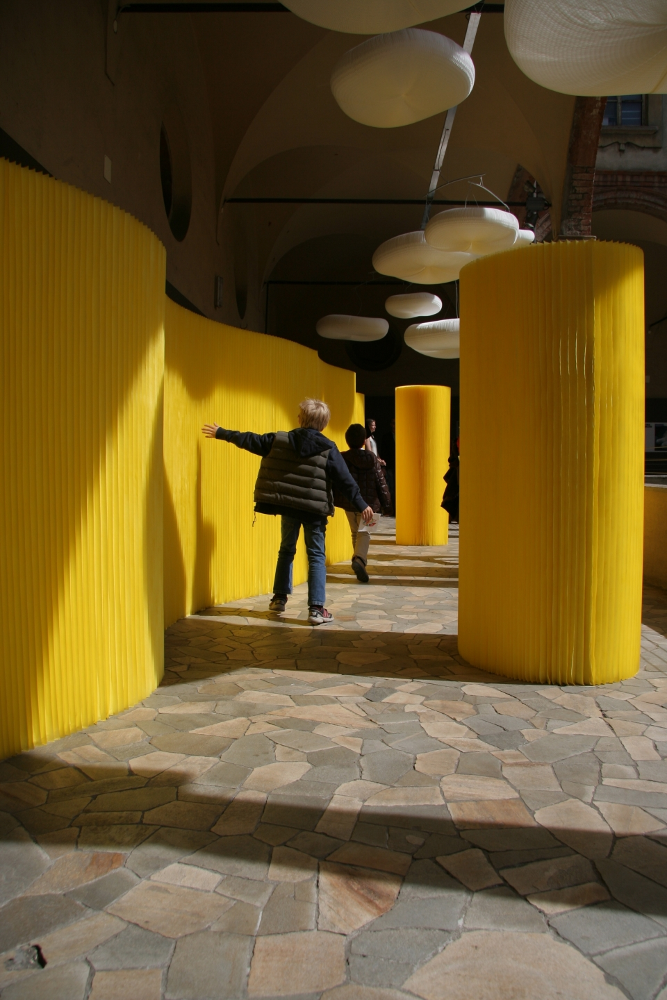 textile softwall room dividers in a custom yellow colour and cloud mobile softlight for MOST in Milan