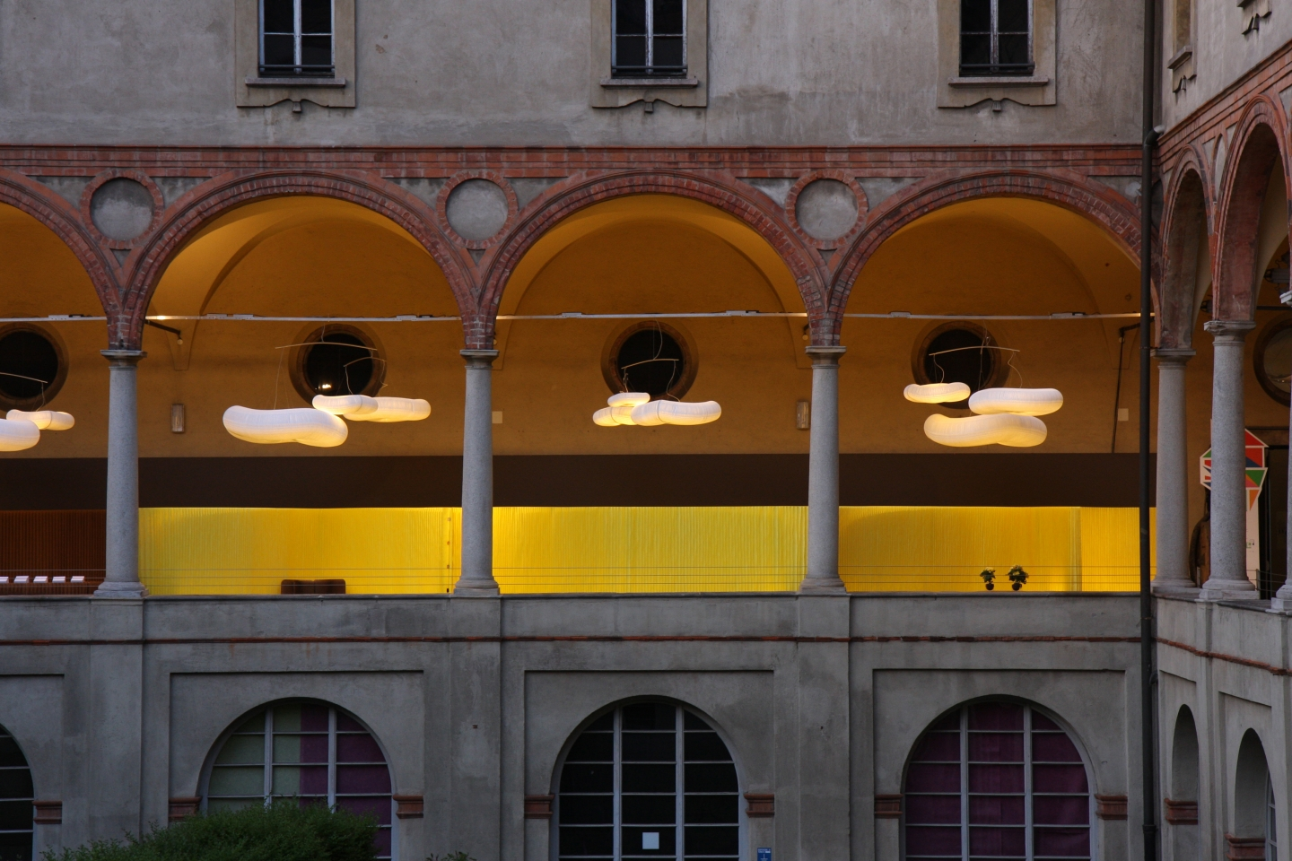 Italian palazzo in Milan with an installation of custom colour textile softwalls + cloud softlight mobile paper lighting
