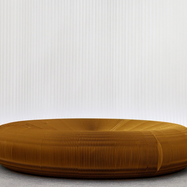 kraft paper lounger against a backdrop of modified textile