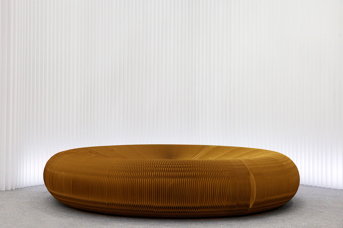 kraft paper lounger against a backdrop of modified textile - by molo