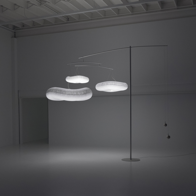 the floor supported light, cloud mast, illuminates a dark space.