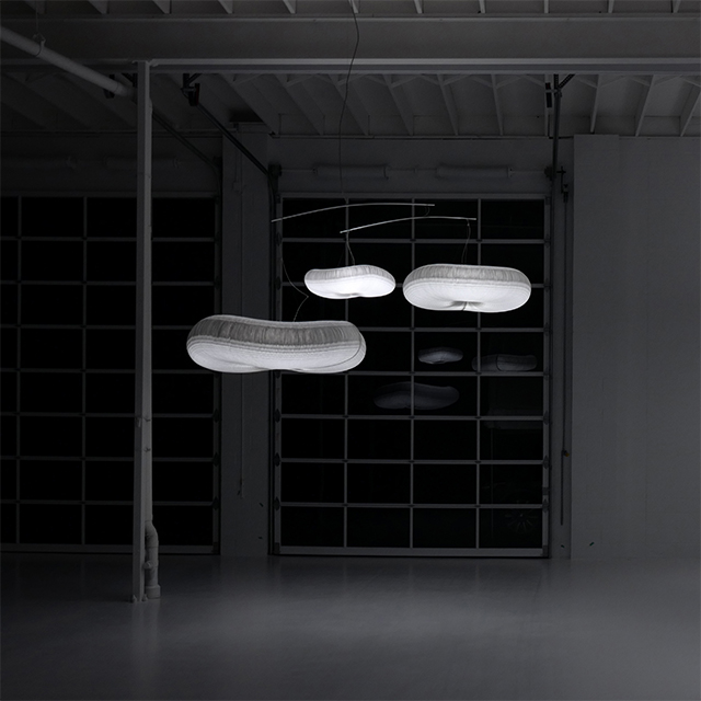 cloud softlight mobile creates mysterious, glowing forms in a dark room.