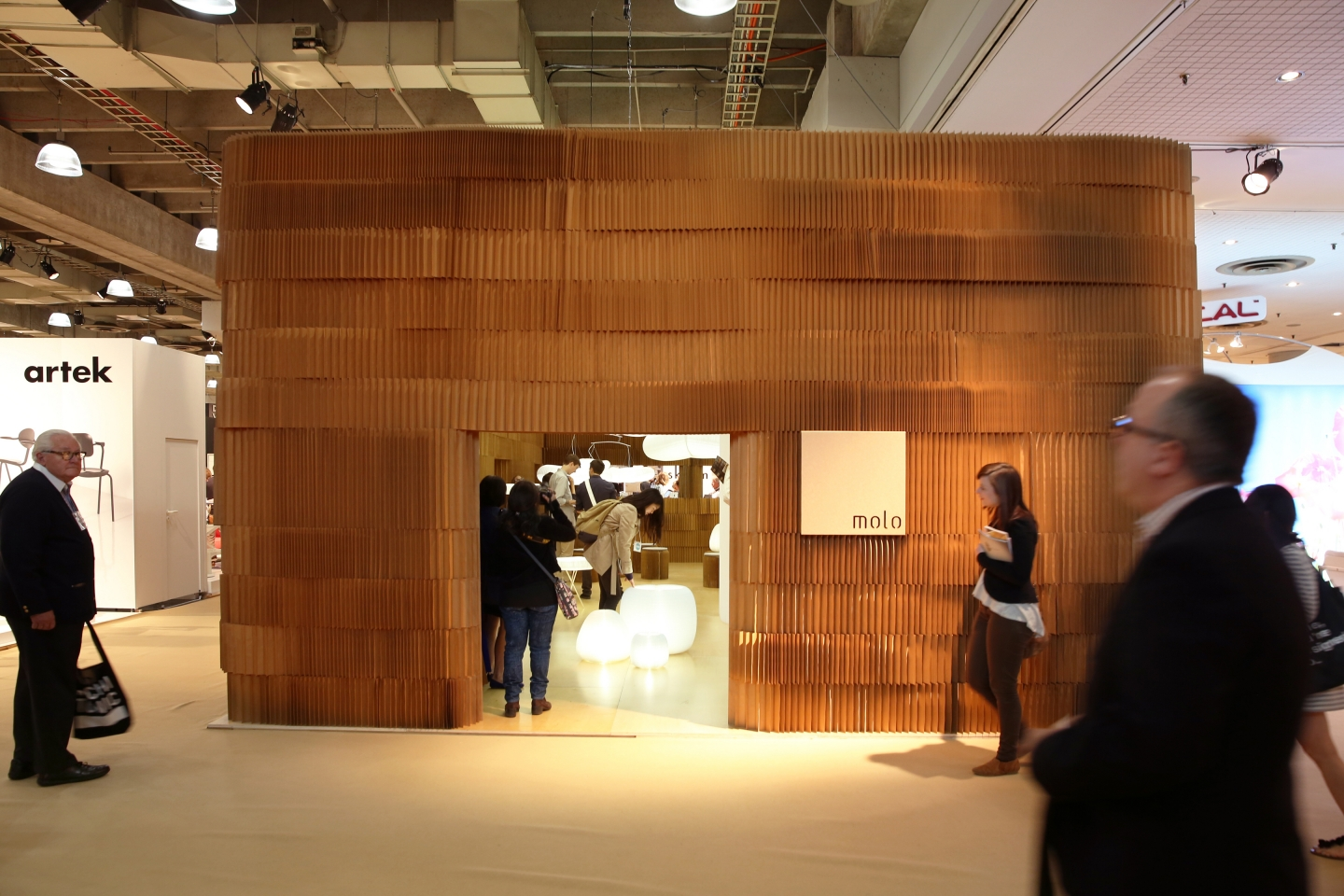 The warm tones of paper softblocks provides a pleasing natural contrast to the white washed trade show neighbours.