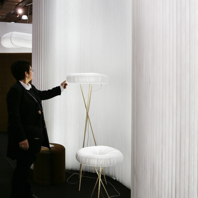 cloud table and floor against a backdrop of illuminated, modified textile softwall