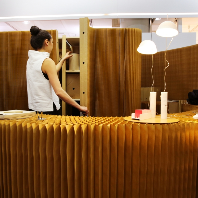 a molo employee retrieves materials from inside a thinwall closet