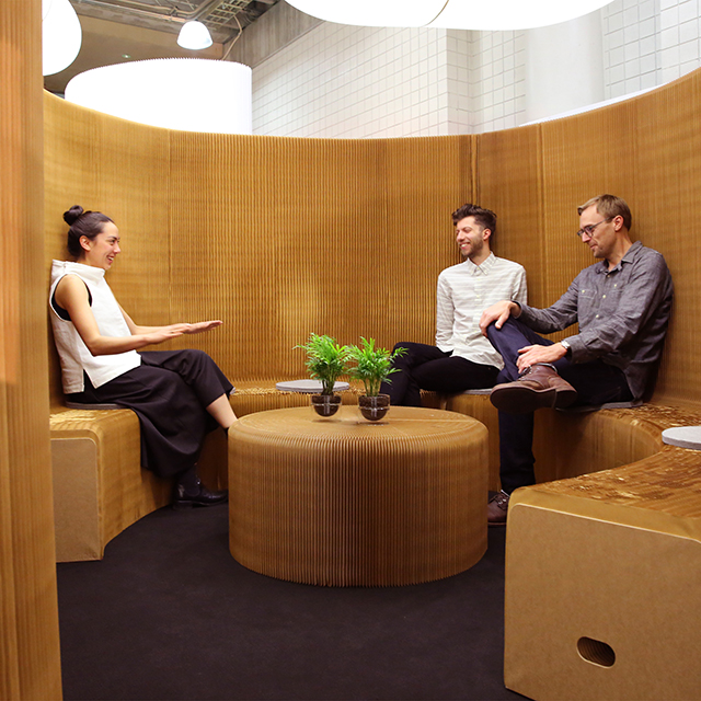 benchwall forms a private meeting room for three coworkers at Neocon - portable acoustic paper furniture