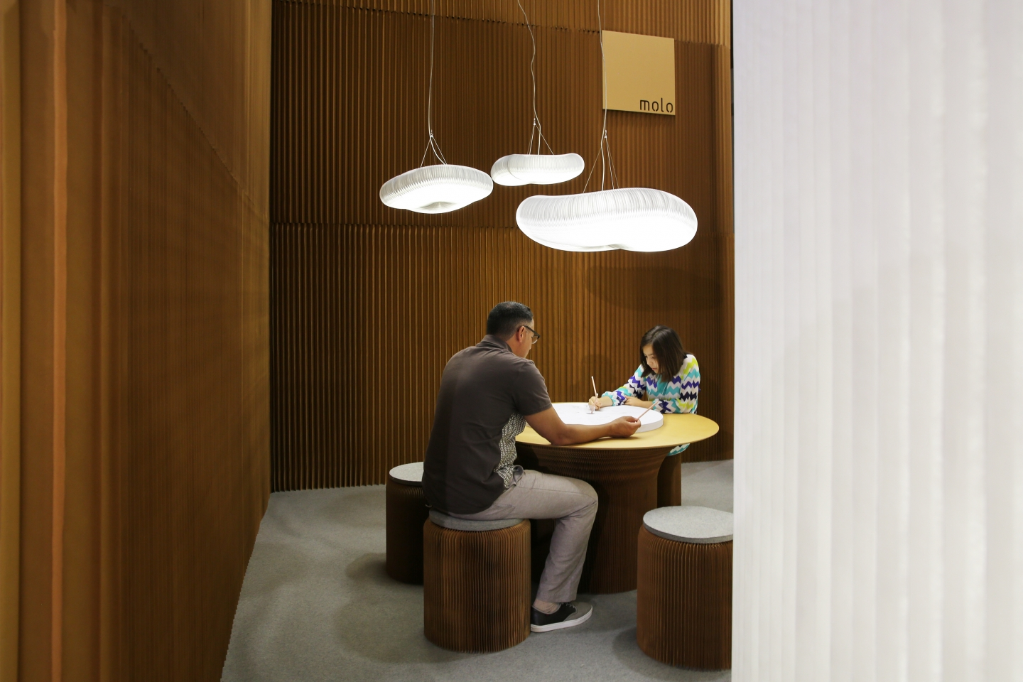 honeycomb paper furniture and cloud lighting by molo - sitting below cloud softlight pendant at ICFF