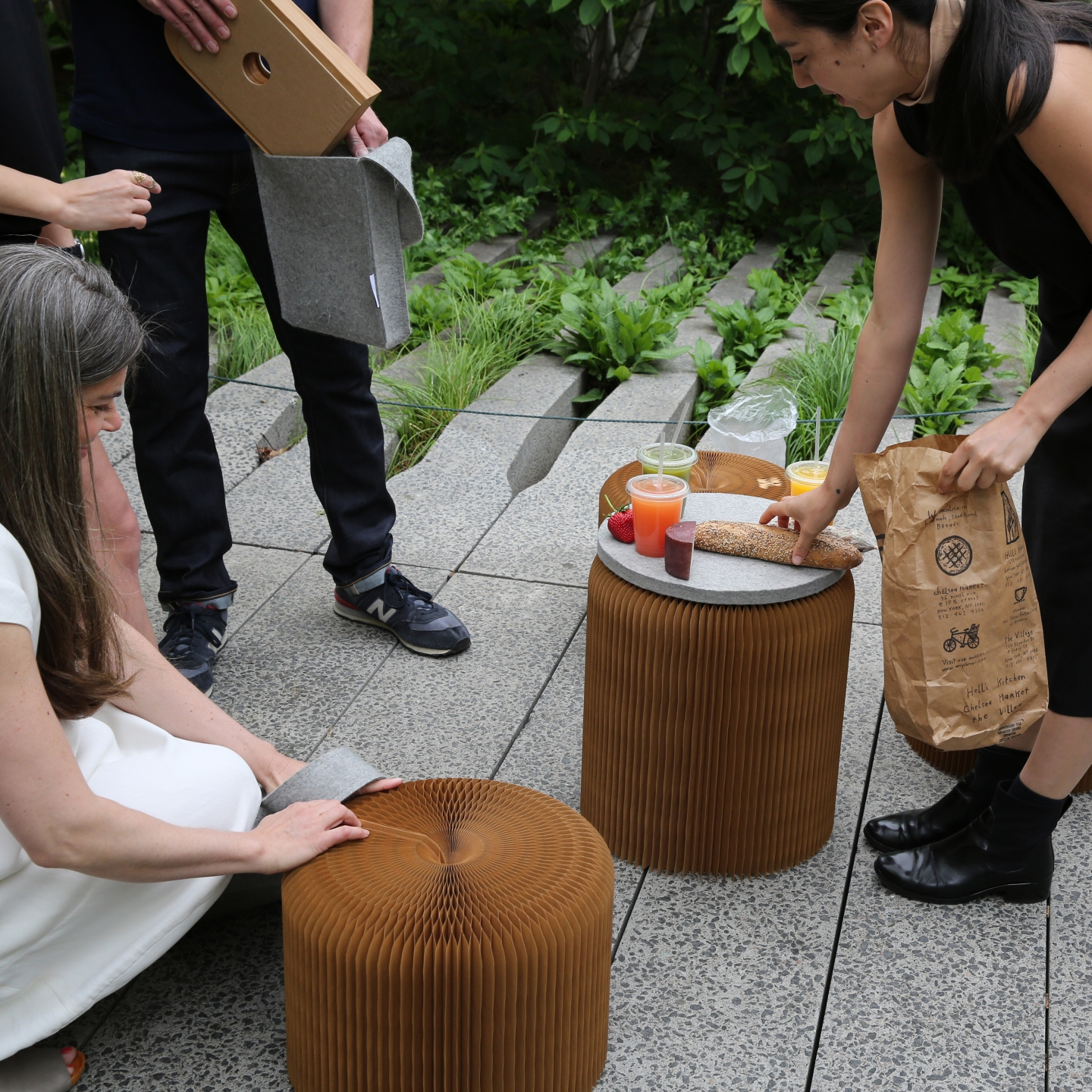 paper seating by molo in NYC USA -a picnic on the Chelsea High Line makes use of softseating with felt pads as spontaneous tables