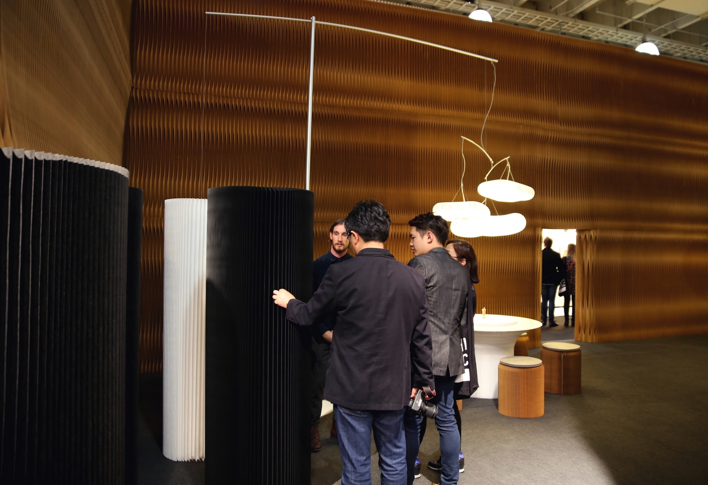paper lighting and accordion paper furniture by molo - demonstrating softwall to guests at ICFF 2016