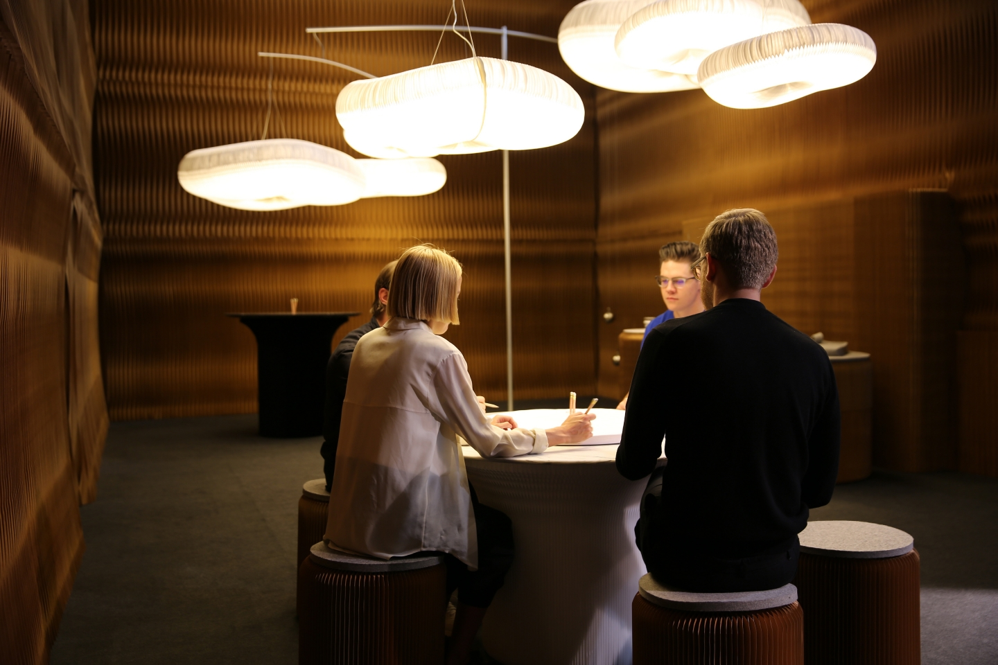 paper lighting and accordion paper furniture by molo - sitting below the clouds at ICFF 2016